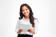 Smiling happpy asian businesswoman holding tablet computer. Isolated on a white background stock images