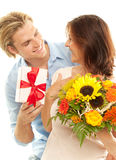Smiling and happy. Blond man makes a gift Stock Photo