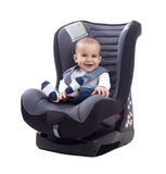 Smiling happy adorable baby sitting in car seat Stock Photos