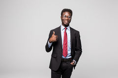 Smiling happy african black executive professional giving a thumbs up in studio. Smiling african black executive professional giving a thumbs up in studio stock image