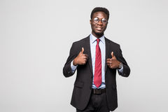 Smiling happy african black executive professional giving a thumbs up in studio. Smiling african black executive professional giving a thumbs up in studio stock photography