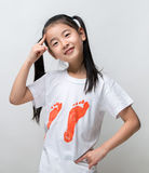 Smiling happy asian girl thinking. Smiling happy asian girl thinking Stock Photography