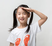 Smiling happy Asian girls saluting. Stock Photo
