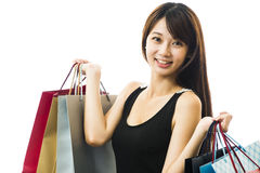 Smiling happy Asian woman shopping Stock Photography