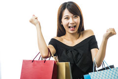 Smiling happy Asian woman shopping Stock Photos