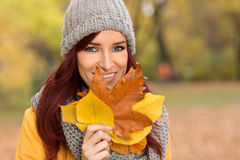 Smiling happy attractive girl holding leaves Royalty Free Stock Photography