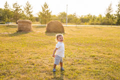 Smiling happy baby boy on natural background in summer. Portrait of smiling happy baby boy on natural background in summer Royalty Free Stock Image