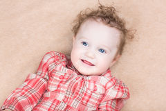 Smiling happy baby girl in a red dress Royalty Free Stock Images