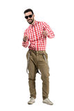 Smiling happy bearded hipster pointing towards camera Royalty Free Stock Images