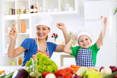 Smiling happy beautiful family ready for cook Royalty Free Stock Photography