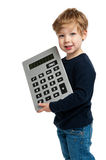 Cute Boy with Big Calculator. Smiling happy boy with a bid calculator shot in the studio on a white background Stock Photography