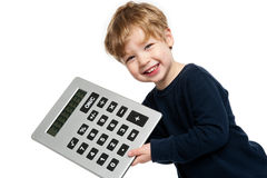 Cute Boy with Big Calculator. Smiling happy boy with big calculator shot in the studio on a white background Royalty Free Stock Image