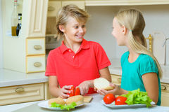 Smiling happy boy and girl making homemade Stock Photography