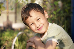 Smiling happy boy outdoors Royalty Free Stock Photo