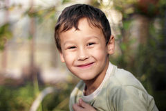 Smiling happy boy outdoors Royalty Free Stock Images