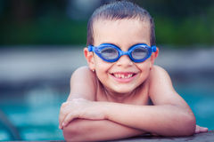 Smiling happy boy in the pool Stock Photo