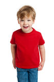 Cute Boy Looking. Smiling happy boy in red T-Shirt shot in the studio on a white background Royalty Free Stock Photography