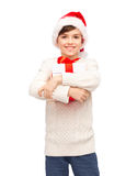 Smiling happy boy in santa hat with gift box Royalty Free Stock Photo