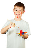 Smiling happy boy with stained coloured hand. Funny boy with stained coloured hand. isolated stock photography