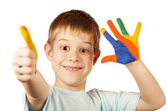Smiling happy boy with stained coloured hand. Funny boy with stained coloured hand. isolated stock photos