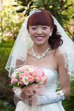 Smiling happy bride with bouquet Stock Photos