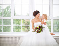 Smiling happy bride and a flower indoors Stock Image