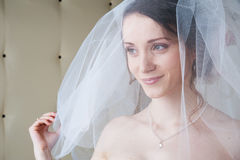 Smiling happy bride with white veil Royalty Free Stock Photography