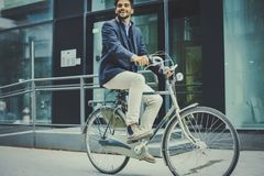 Business man driving bicycle. Businessman on bike. stock photo