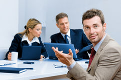 Smiling happy business man in office Stock Photo