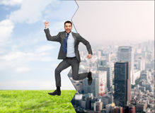 Smiling happy businessman jumping Royalty Free Stock Images