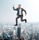 Smiling happy businessman jumping Royalty Free Stock Photo
