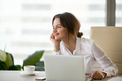 Smiling happy businesswoman feeling motivated dreaming about fut royalty free stock photos
