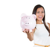 Smiling happy businesswoman holding pink piggy bank Stock Photography
