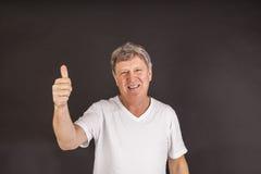Smiling happy casual dressed man in studio Stock Photos