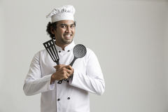 Smiling happy chef holding kitchen utensil Royalty Free Stock Photography