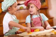 Smiling happy children makin cookies in kitchen Royalty Free Stock Image