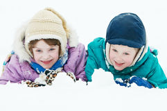 Smiling happy children at winter snow outdoors Royalty Free Stock Photos