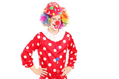 Smiling happy clown in red costume posing. Isolated on white background Royalty Free Stock Photo