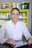 View of an attractive pharmacist at work royalty free stock images