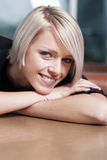 Smiling happy contented young woman Royalty Free Stock Images