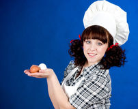 Smiling happy cook woman Stock Image