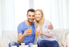 Smiling happy couple at home drinking juice Stock Photo