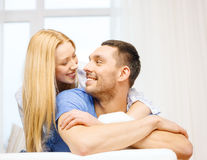 Smiling happy couple at home. Love, family and happiness concept - smiling happy couple at home Stock Photo