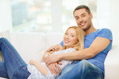 Smiling happy couple at home Stock Photography