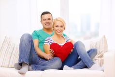 Smiling happy couple with red heart at home Royalty Free Stock Photo