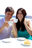Smiling happy couple in vacation having breakfast in hotel Royalty Free Stock Photo