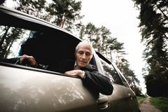 Smiling happy elderly man and his new car royalty free stock photos