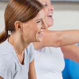 Smiling happy elderly woman. Smiling happy elderly women exercising in gym royalty free stock images