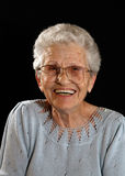Smiling Happy Elderly Woman on Black Royalty Free Stock Image