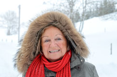 Smiling happy elderly woman outdoors in winter Royalty Free Stock Photography